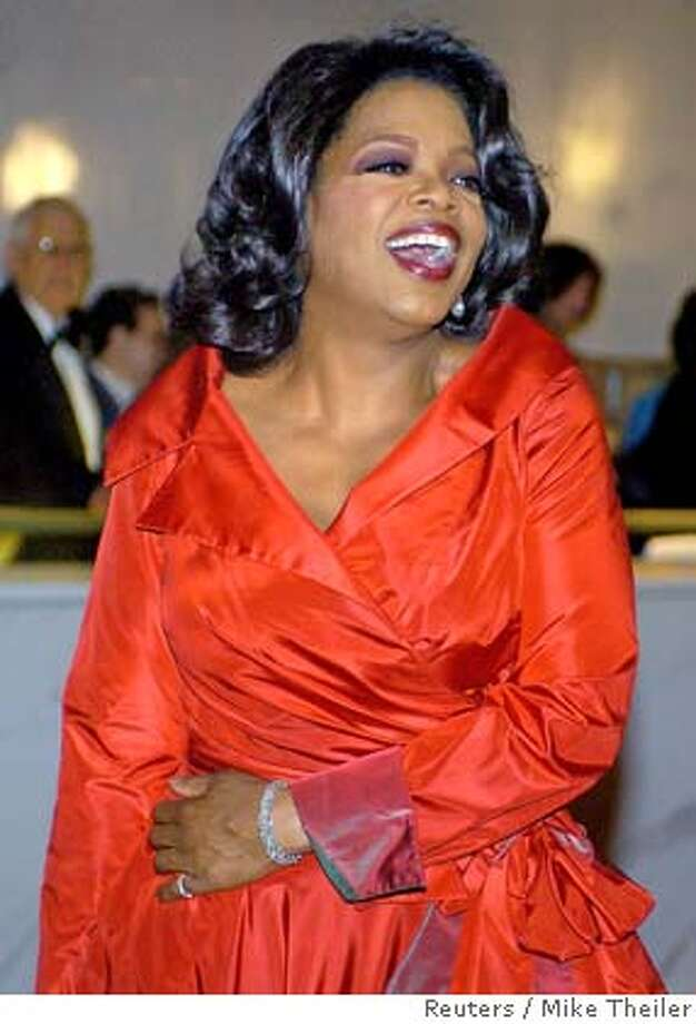 "Talk show host Oprah Winfrey poses as she arrives at the Kennedy Center in Washington for a gala performance in this December 4, 2005 file photo. Winfrey threw her support to embattled author James Frey on Wednesday, saying a national uproar over whether he fictionalized parts of his best-selling memoir was ""much ado about nothing."" REUTERS/Mike Theiler/File 0 Photo: MIKE THEILER"