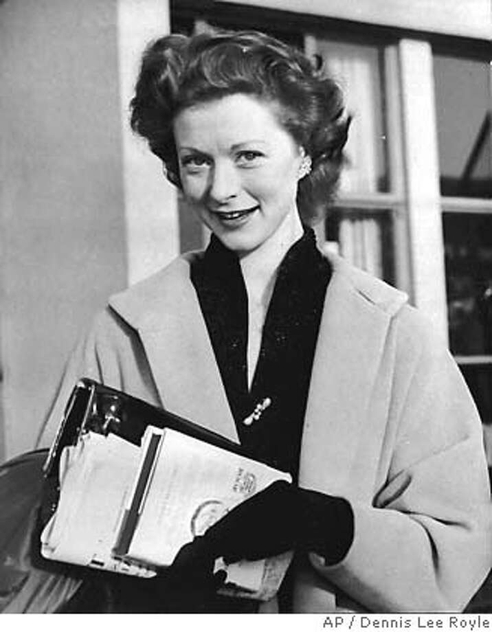 "**FILE** Moira Shearer is shown at a London airport in 1954. The ballerina and actress whose debut film, ""The Red Shoes,"" created an international sensation in 1948, died Tuesday, Jan. 31, 2006, at an Oxford, England, hospital, her husband said. She was 80.(AP Photo/Dennis Lee Royle) A 1954 FILE PHOTO Photo: DENNIS LEE ROYLE"