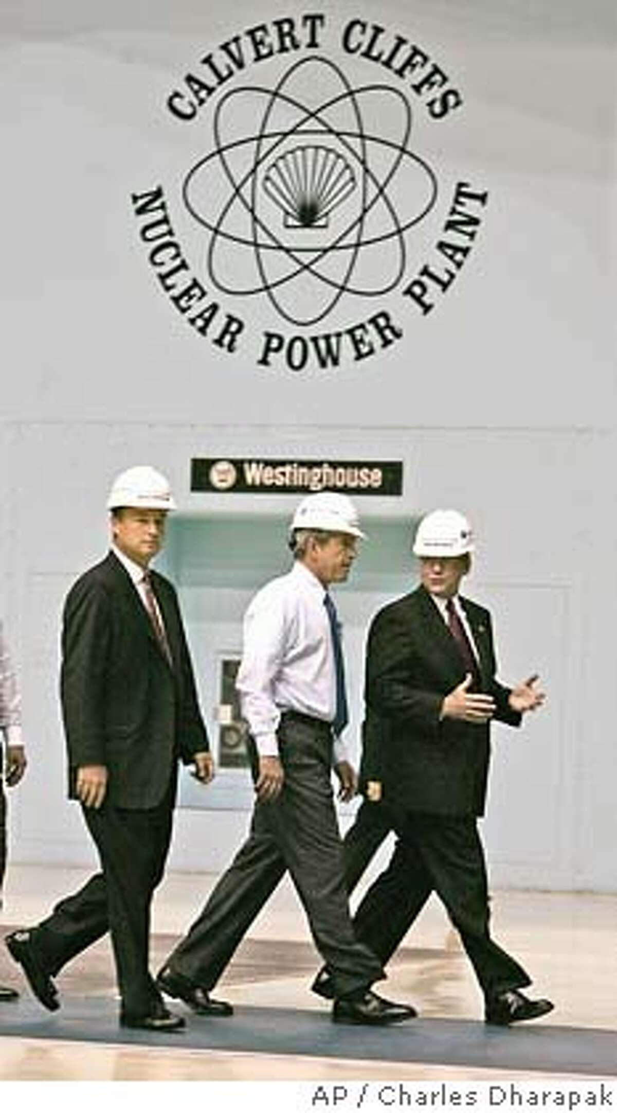 President Bush, center, tours the turbine room of Calvert Cliffs Nuclear Power Plant with Mike Wallace, President of Constellation Generation, right, and Mayo Shattuck, chairman, president, and CEO of Constellation Energy in Lusby, Md., Wednesday, June 22, 2005. President Bush later spoke about energy and economic security at the facility. (AP Photo/Charles Dharapak)