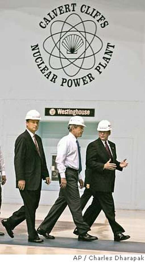 President Bush, center, tours the turbine room of Calvert Cliffs Nuclear Power Plant with Mike Wallace, President of Constellation Generation, right, and Mayo Shattuck, chairman, president, and CEO of Constellation Energy in Lusby, Md., Wednesday, June 22, 2005. President Bush later spoke about energy and economic security at the facility. (AP Photo/Charles Dharapak) Photo: CHARLES DHARAPAK