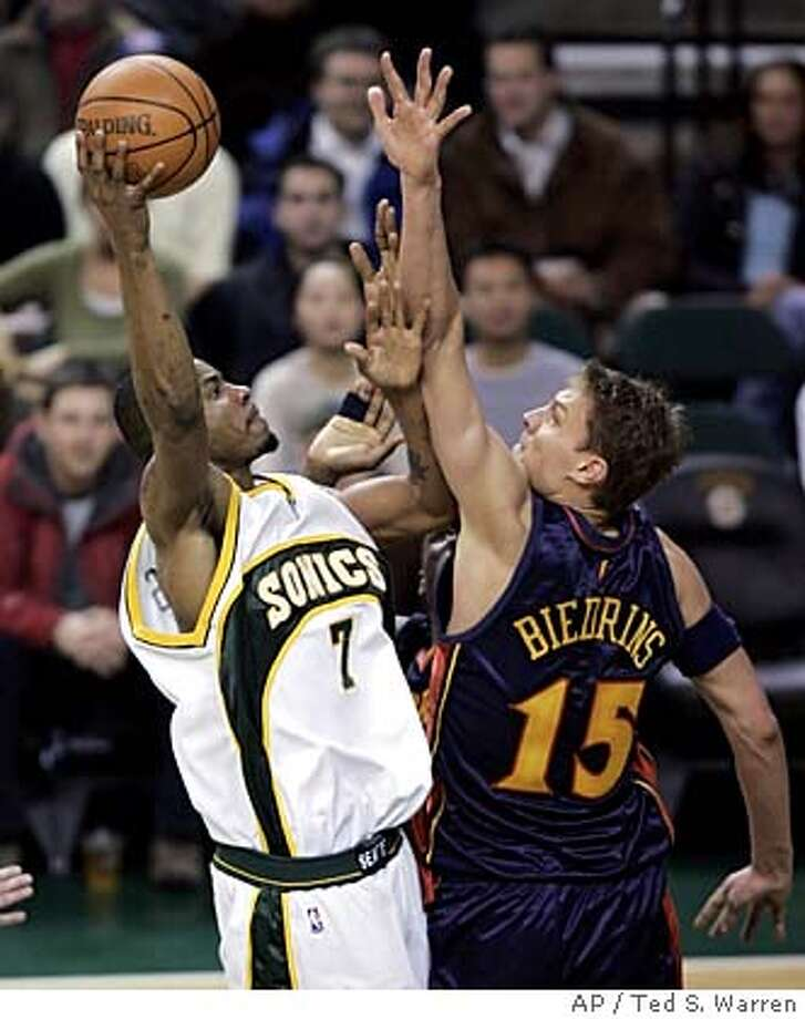 Seattle SuperSonics forward Rashard Lewis, left, shoots past Golden State Warriors forward Andris Biedrins, of Latvia, during the third period NBA basketball action Wednesday, Feb. 1, 2006 at KeyArena in Seattle. (AP Photo/Ted S. Warren) Photo: TED S. WARREN