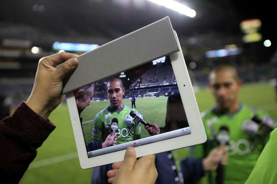 Sounders player David Estrada is interviewed after his hat trick during the Seattle Sounders MLS season opener against Toronto FC on Saturday, March 17, 2012 at CenturyLink Field in Seattle. Photo: JOSHUA TRUJILLO / SEATTLEPI.COM