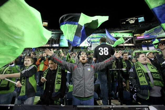 Fans celebrate at CenturyLink Field. Photo: JOSHUA TRUJILLO / SEATTLEPI.COM