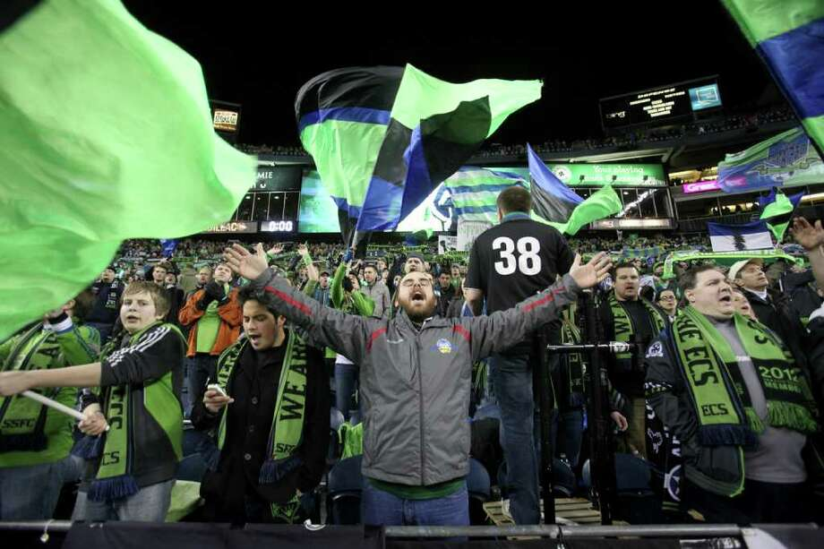Fans celebrate during the Seattle Sounders MLS season opener against Toronto FC on Saturday, March 17, 2012 at CenturyLink Field in Seattle. Photo: JOSHUA TRUJILLO / SEATTLEPI.COM
