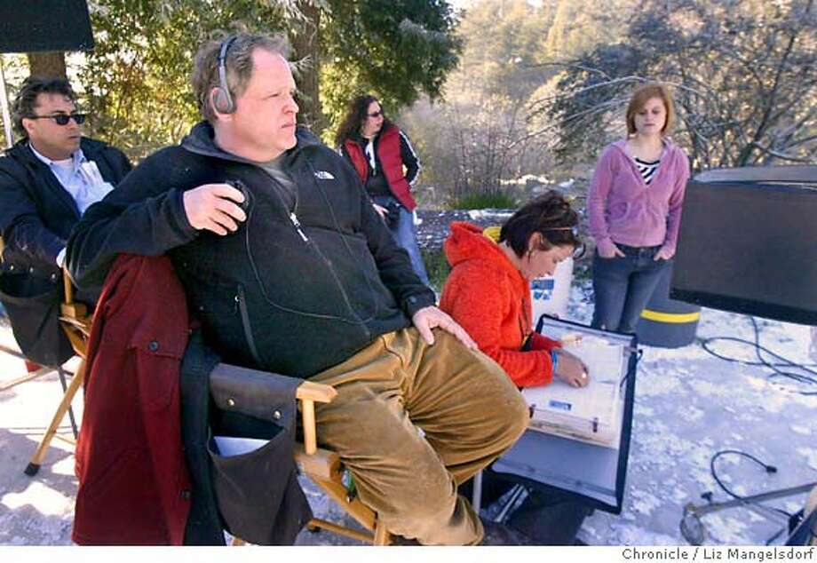 taylor07_01_lm.JPG Event on 2/2/05 in Oakland.  Film director Finn Taylor watches a scene through a monitor on the set of his new film. There is fake snow on the ground. He is filming his new movie at Joaquin Miller Park in Oakland. Liz Mangelsdorf / The Chronicle Photo: Liz Mangelsdorf