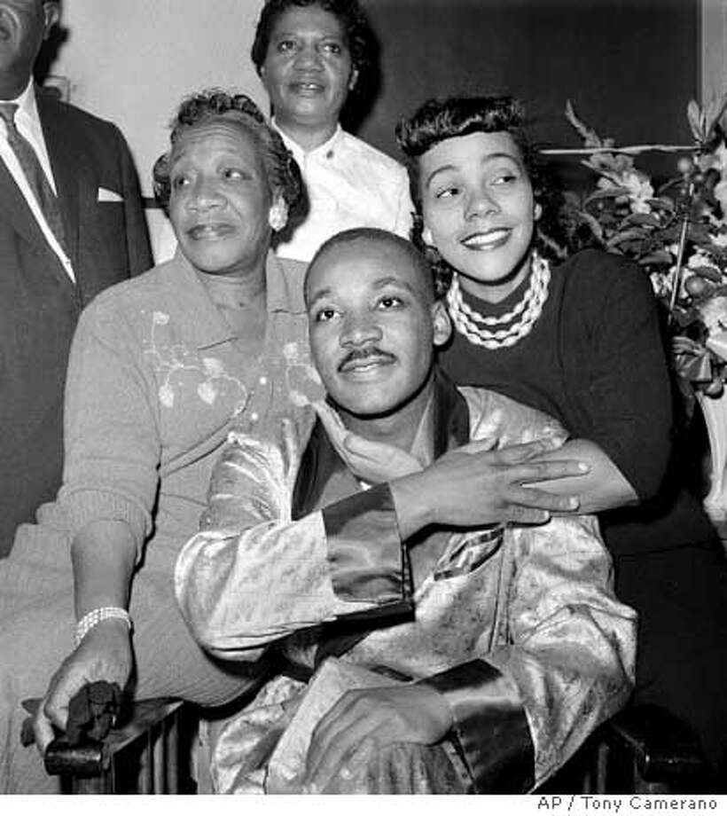 ** FILE ** Dr. Martin Luther King, Jr., is embraced by his wife Coretta Scott King during a news conference at Harlem Hospital in New York, in this Sept. 30, 1958 file photo, where he was recovering from a stab wound following an attack by a woman. At left is his mother, Alberta Williams King. Scott King, who turned a life shattered by her husband's assassination into one devoted to enshrining his legacy of human rights and equality, has died, former mayor Andrew Young told NBC Tuesday, morning, Jan. 31, 2006. She was 78. (AP Photo/Tony Camerano, File) Photo: TONY CAMERANO