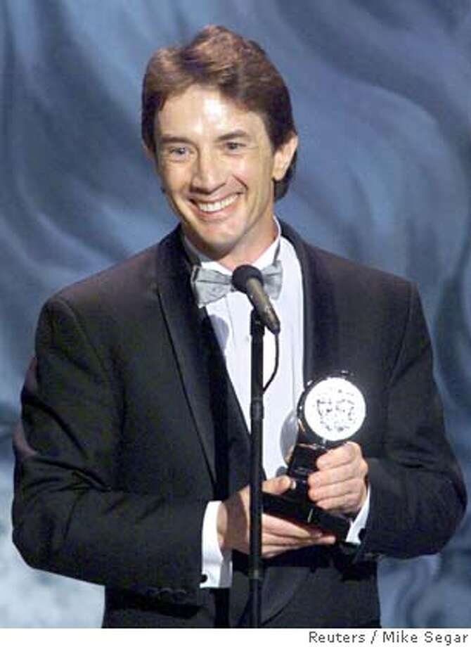 "NYT13D:TONYS:NEW YORK,6JUN99 - Actor Martin Short accepts his Tony Award in the Leading Actor in a Musical category for his performance in ""Little Me"" June 6. pm/Photo by Mike Segar REUTERS ALSO RAN: 9/13/99 CAT Photo: MIKE SEGAR"