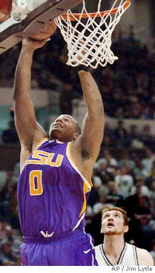 Louisiana State's Glen Davis, left, drives to the basket past Mississippi State's Piotr Stelmach during the second half of their college basketball game in Starkville, Miss., Wednesday, Jan. 18, 2006. LSU won 71-57. (AP Photo/Jim Lytle) Ran on: 02-01-2006  Glen Davis, at 6-9, 310 pounds, has helped LSU stay unbeaten in Southeastern Conference play. Ran on: 02-01-2006  Glen Davis, at 6-9, 310 pounds, has helped LSU stay unbeaten in Southeastern Conference play. Photo: JIM LYTLE