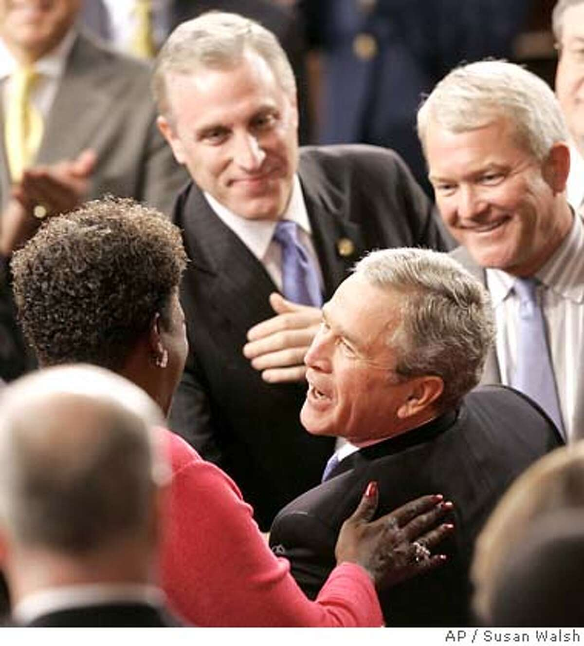 President Bush is greeted by Rep. Stephanie Tubbs Jones, D-Ohio, on Capitol Hill, Tuesday, Jan. 31, 2006, prior to delivering his State of the Union address. Rep. Mark Foley, R-Fla. is at right. (AP Photo/Susan Walsh)