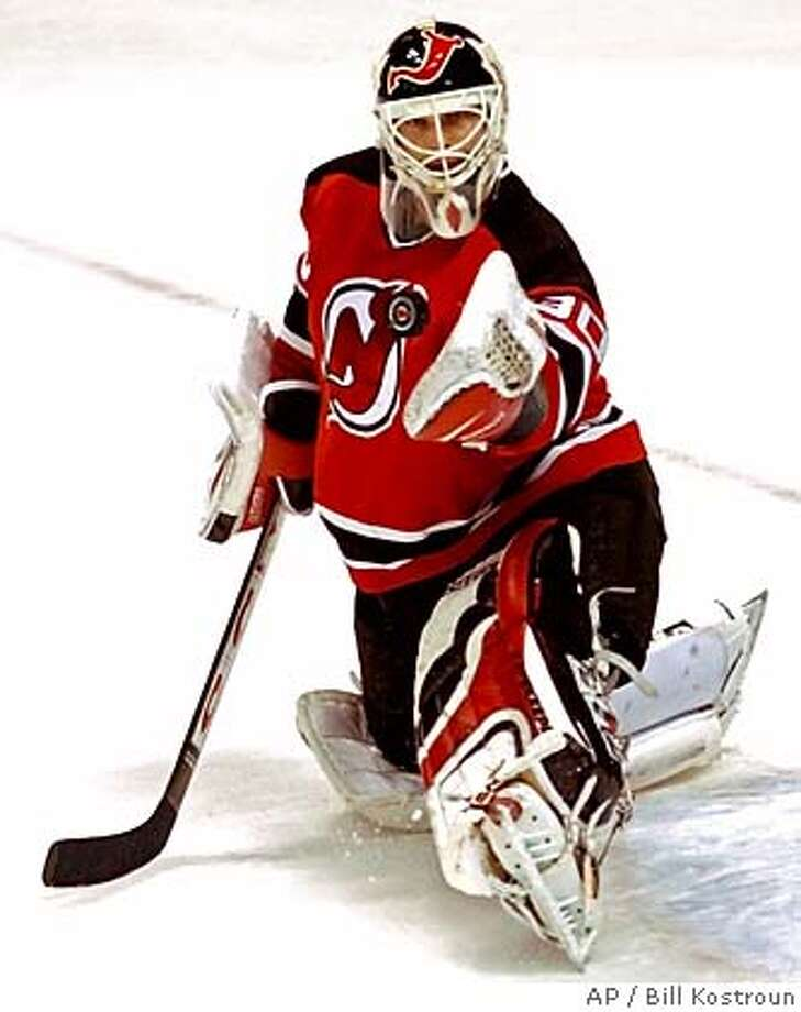 New Jersey Devils goaltender Martin Brodeur makes a save during the third period against the New York Rangers Saturday, Nov. 15, 2003, in East Rutherford, N.J. Brodeur stopped all 18 Rangers shots as the Devils beat the Rangers 5-0. (AP Photo/Bill Kostroun) Martin Brodeur makes one of 18 saves against the Rangers en route to getting his 67th career shutout, the leader among active goalies. Photo: BILL KOSTROUN