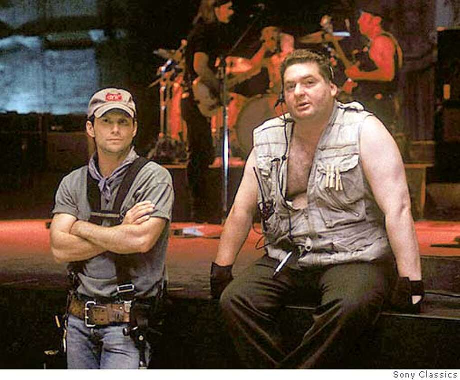 """ATTENTION EDITORS - REPEATING WITH IDENTITY OF PERSON ON LEFT. HE IS HOLLYWOOD ACTOR CHRISTIAN SLATER.  Actors Chris Penn (R) and Christian Slater are shown in a scene from the 2003 film """"Masked and Anonymous"""" in this undated publicity photo. Penn has died in a Santa Monica residence, with no signs of foul play, a local ABC television affiliate reported on January 24, 2006. NO ARCHIVES REUTERS/Sony Classics/Handout 0 Photo: HO"""