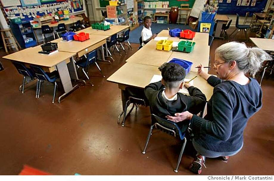 BOYCOTT_319 1/31/06  In a 1st grade class, teacher Elizabeth Fortier-Levett works with the two students who attended her class today.  Boycott of John Swett School in San Francisco and students that attend the school but stay at home at the Baker family home. The Bakers are organizers of the boycott. Photography by Mark Costantini / San Francisco Chronicle Photo: MARK COSTANTINI