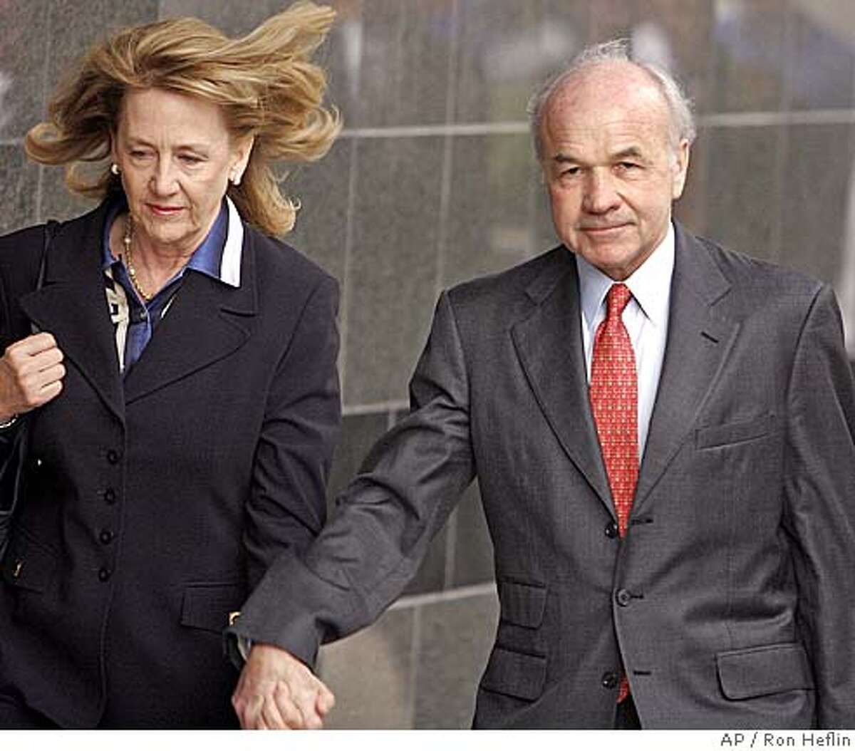 Walking hand in hand with his wife Linda, former Enron founder Ken Lay enters the federal courthouse in Houston, Monday, Jan. 30, 2006 for the first day of his trial on fraud and conspiracy. (AP Photo/Ron Heflin)