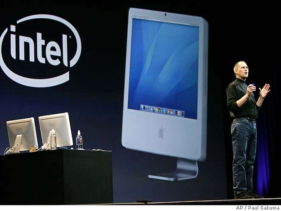 ** FILE ** Apple Computer, Inc. CEO Steve Jobs gestures in front of an Apple iMac powered by an Intel Corp. processor at the MacWorld conference in a San Francisco file photo from Jan. 10, 2006. The new chips give the iMac a noticeable boost in performance, though not quite the gains suggested when Apple CEO Steve Jobs unveiled the machines. They seem to run cooler, which suggests lower power and could be good news for future Intel-based Mac laptops. (AP Photo/Paul Sakuma, File) Photo: PAUL SAKUMA