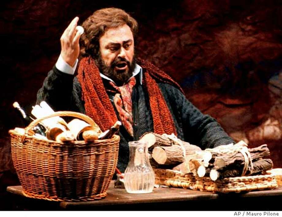 "**FILE**Italian tenor Luciano Pavarotti performs as Rodolfo during the dress rehearsal of Giacomo Puccini's ""La Boheme"" at the Regia Theatre in Turin in this Jan. 30, 1996 file photo. Pavarotti, whose vibrant high C's and ebullient showmanship made him one the most beloved tenors, has died, his manager told The Associated Press Thursday Sept. 6, 2007. He was 71. (AP Photo/Mauro Pilone) Photo: MAURO PILONE"
