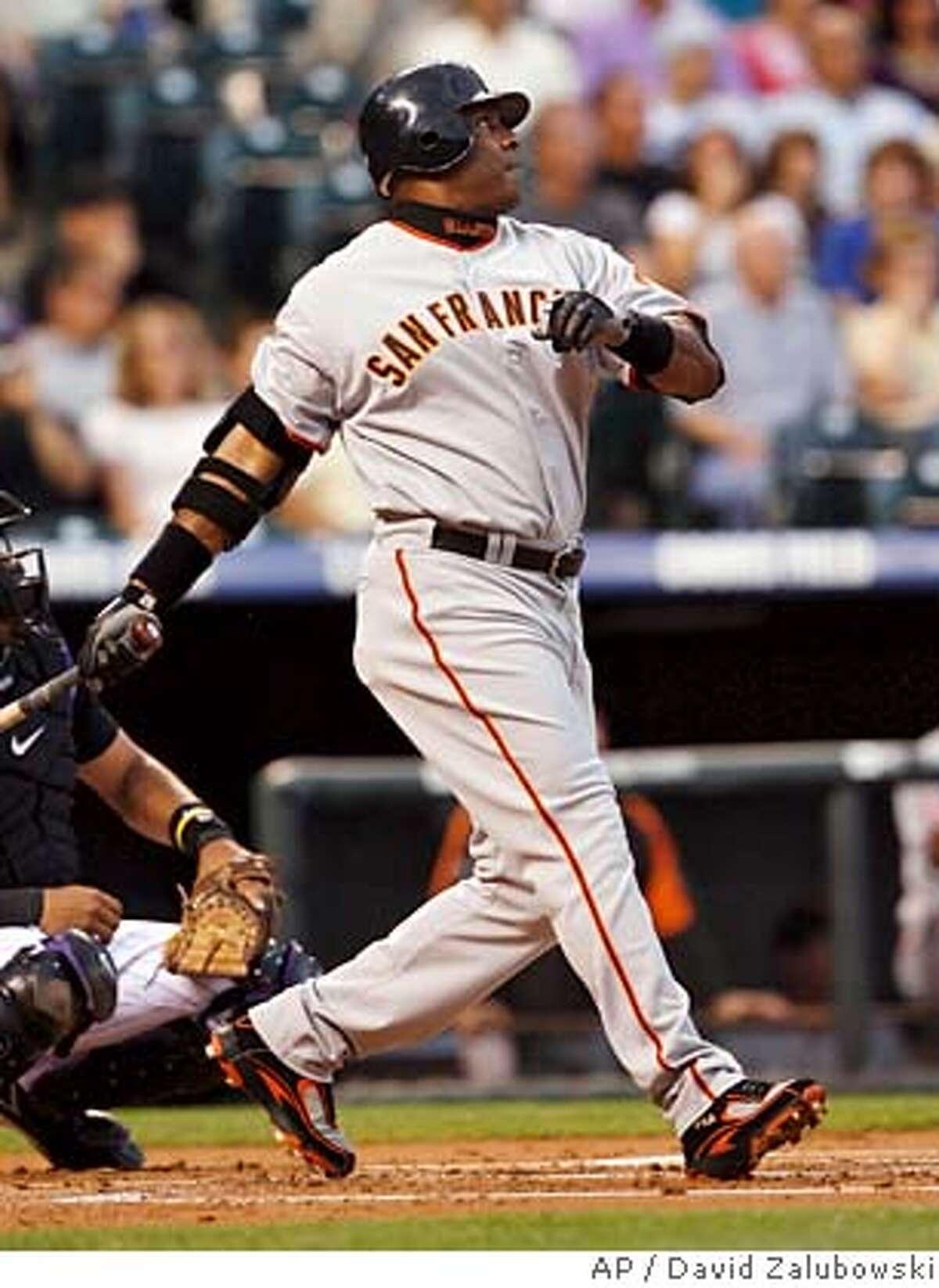 San Francisco Giants' Barry Bonds follows the flight of his two-run home run off Colorado Rockies starting pitcher Ubaldo Jimenez in the first inning of a baseball game in Denver on Wednesday, Sept. 5, 2007. (AP Photo/David Zalubowski)