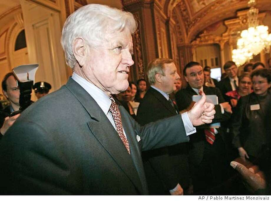 Sen. Edward Kennedy, D-Mass., left, gives a thumbs-up as he and Sen. Richard Durbin, D-Ill., center, meet with supporters outside the Senate Chambers after a failed last minute attempt to block Samuel Alito's nomination with a filibuster, Monday, Jan. 30, 2006 in Washington. (AP Photo/Pablo Martinez Monsivais) Photo: PABLO MARTINEZ MONSIVAIS