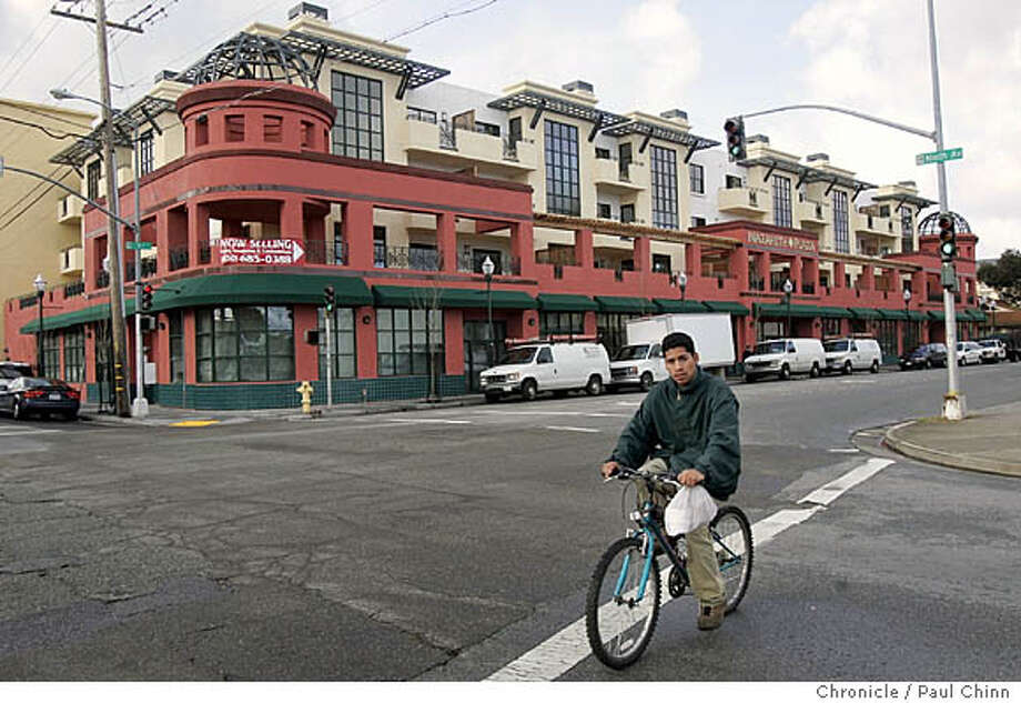 nazareth29_004_pc.jpg  A bicyclist rides past the Nazareth Plaza condominium development in San Mateo, Calif. on 1/18/06.  PAUL CHINN/The Chronicle MANDATORY CREDIT FOR PHOTOG AND S.F. CHRONICLE/ - MAGS OUT Photo: PAUL CHINN