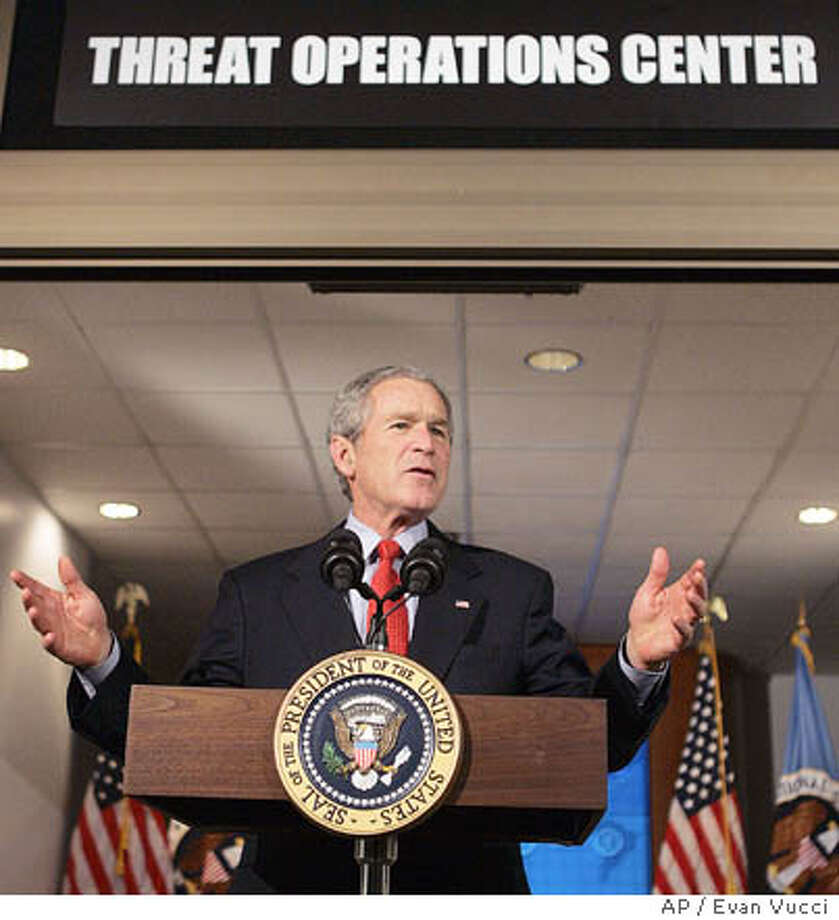 President Bush gestures during a statement at the National Security Agency on Wednesday, Jan. 25, 2006, in Fort Meade, Md. Bush travelled to the heavily-secured site of the super-secret spy agency in suburban Maryland to give a speech behind closed doors and meet with employees in advance of Senate hearings on the much-criticized domestic surveillance. (AP Photo/Evan Vucci) Photo: EVAN VUCCI