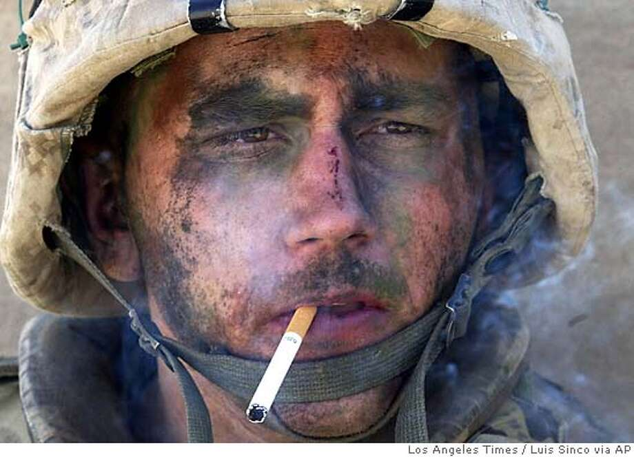A member of Charlie Company of the U.S. Marines First Division, Eighth regiment, smokes a cigarette in Fallujah, Iraq, Tuesday, Nov. 9, 2004. U.S. forces punched into the center of the insurgent stronghold, overwhelming bands of guerrillas in the street with heavy barrages of fire and searching house to house in a powerful advance on the second day of a major offensive. (AP Photo/Los Angeles Times, Luis Sinco) ** MANDATORY CREDIT, , NO FOREIGN, NO MAGS, LOS ANGELES DAILY NEWS OUT, OC REGISTEROUT, VENTURA COUNTY STAR OUT, INLAND VALLEY DAILY BULLETIN OUT, SAN BERNARDINO SUN OUT ** Ran on: 11-18-2004  Marine Lance Cpl. James Blake Miller has become an unwitting poster boy for the war in Iraq. MANDATORY CREDIT: LUIS SINCO/LOS ANGELES TIMES, , NO FOREIGN, NO MAGS, LOS ANGELES DAILY NEWS OUT, OC REGISTER OUT, VENTURA COUNTY STAR OUT, INLAND VALLEY DAILY BULLETIN OUT, SAN BERNARDINO SUN OUT Ran on: 11-20-2004  Heroic?: Photo of Marine sends wrong message, many readers say. Ran on: 01-07-2005  Face that launched a billion butts: Life photographer Leonard McCombe shot this image of Texas rancher C.H. Long in 1949. The image inspired Chicago adman Leo Burnett in the makeover of Marlboro as a more manly cigarette. Ran on: 01-29-2006  Blake Miller sits with his wife, Jessica, and Candi at the home where she grew up in Virgie, Ky. The couch is theirs, the flag blanket from his grandmother Mildred. Photo: LUIS SINCO