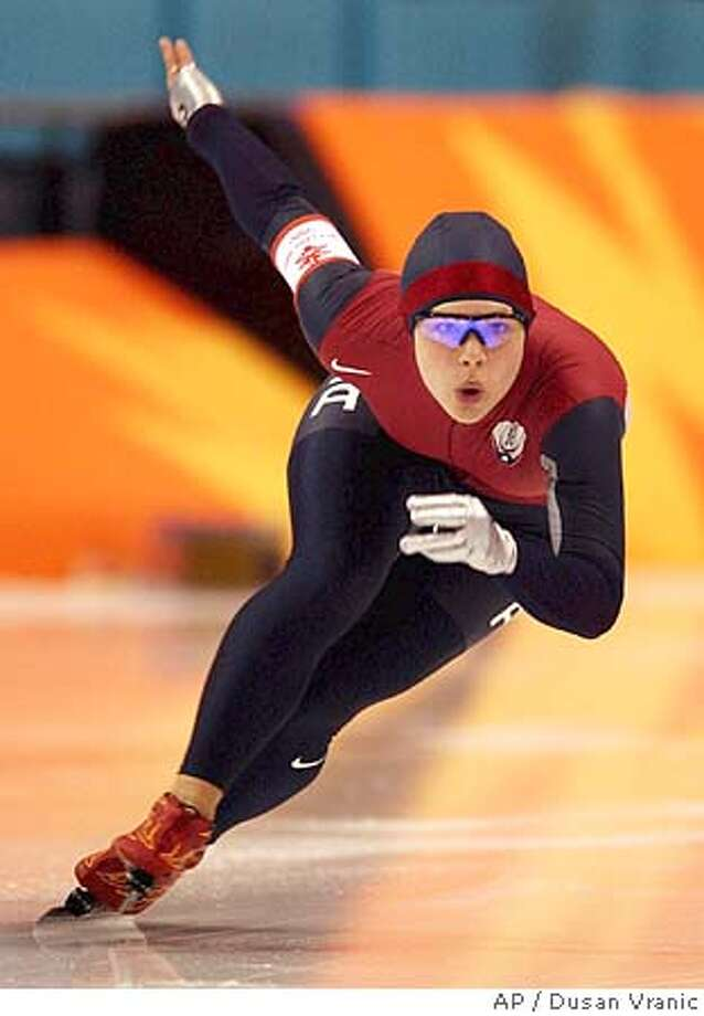 Elli Ochowicz of the United States makes a turn during the second of two races in the women's 500-meter Olympic speed skating competition in Salt Lake City, Thursday, Feb. 14, 2002. Ochowicz finished with a time of 38.86. Elli's mother, Sheila Young, set the Olympic record in the 500-meter event at the 1976 games in Innsbruck. (AP Photo/Dusan Vranic) DIGITAL IMAGE Photo: DUSAN VRANIC
