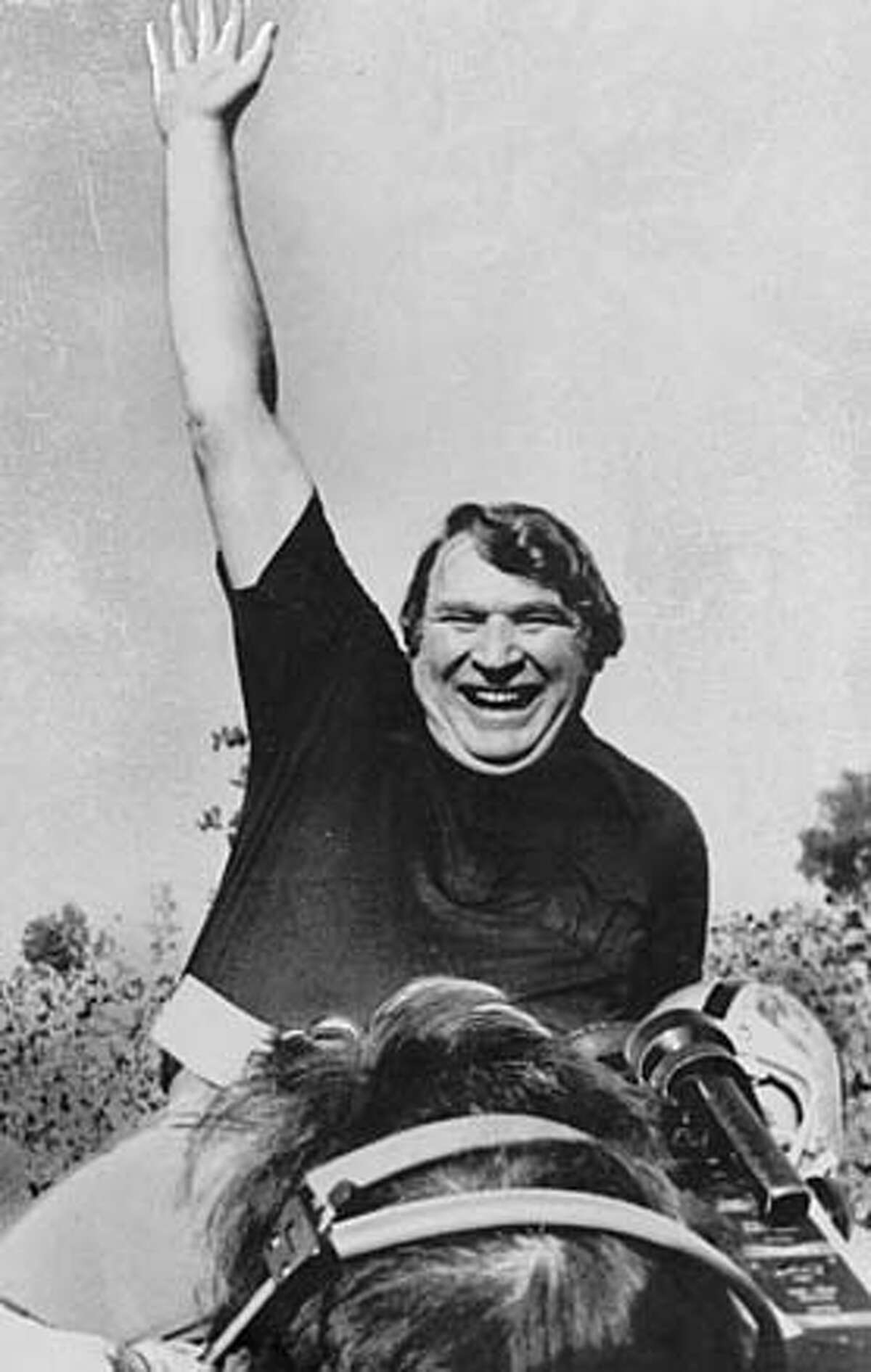 John Madden is carried off field after the Raiders beat the Vikings in the Super Bowl.