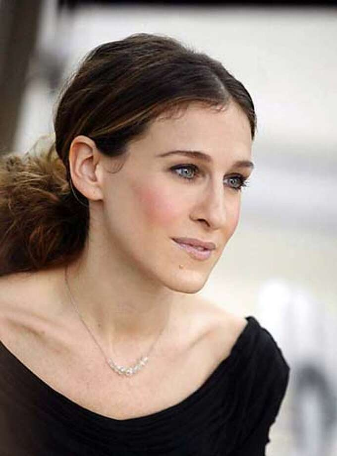 "Sarah Jessica Parker, in the role of Carrie Bradshaw in the finale of HBO Television's ""Sex in the City,"" wears a necklace in a scene for the series shot in Paris, in this recent but undated publicity photo. When Bradshaw broke her Russian lover's heart and the necklace he'd given her in the finale, the jewelry had a stunt double. The real necklace, consisting of nine diamond beads on a platinum chain and valued at $55,000, remains intact, said New York jeweler Fred Leighton.(AP Photo/HBO Sarah Jessica Parker: Budding role model. The Council of Fashion Designers of America nominated Ralph Rucci, left, and Sean Combs for best women's and men's designers. Sarah Jessica Parker, right, will receive the fashion icon award. ALSO RAN 4/4/04 Photo: Xx"