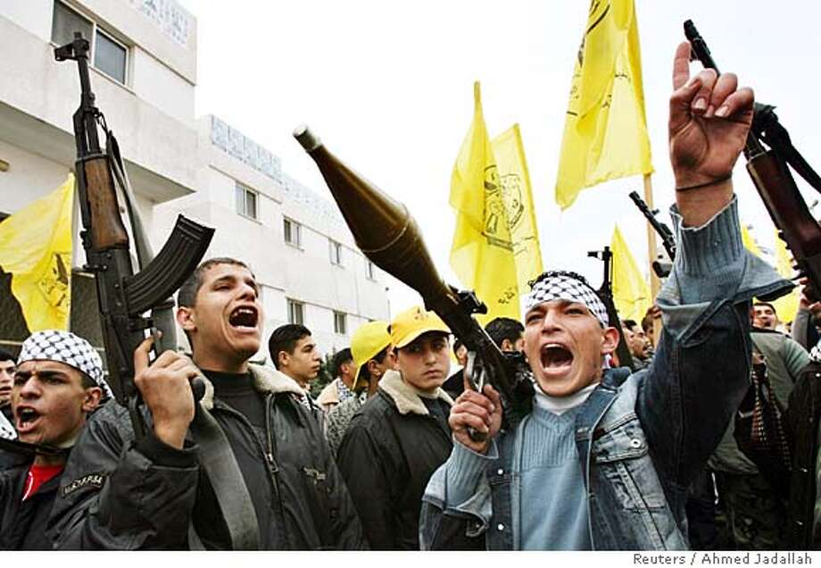Armed men from Fatah chant slogans during a protest in Gaza City January 28, 2006. Fatah gunmen and Palestinian police, angry at Hamas's election victory, briefly took over parliament buildings in the West Bank and Gaza Strip on Saturday, firing in the air, witnesses said. REUTERS/Ahmed Jadallah 0 Photo: AHMED JADALLAH