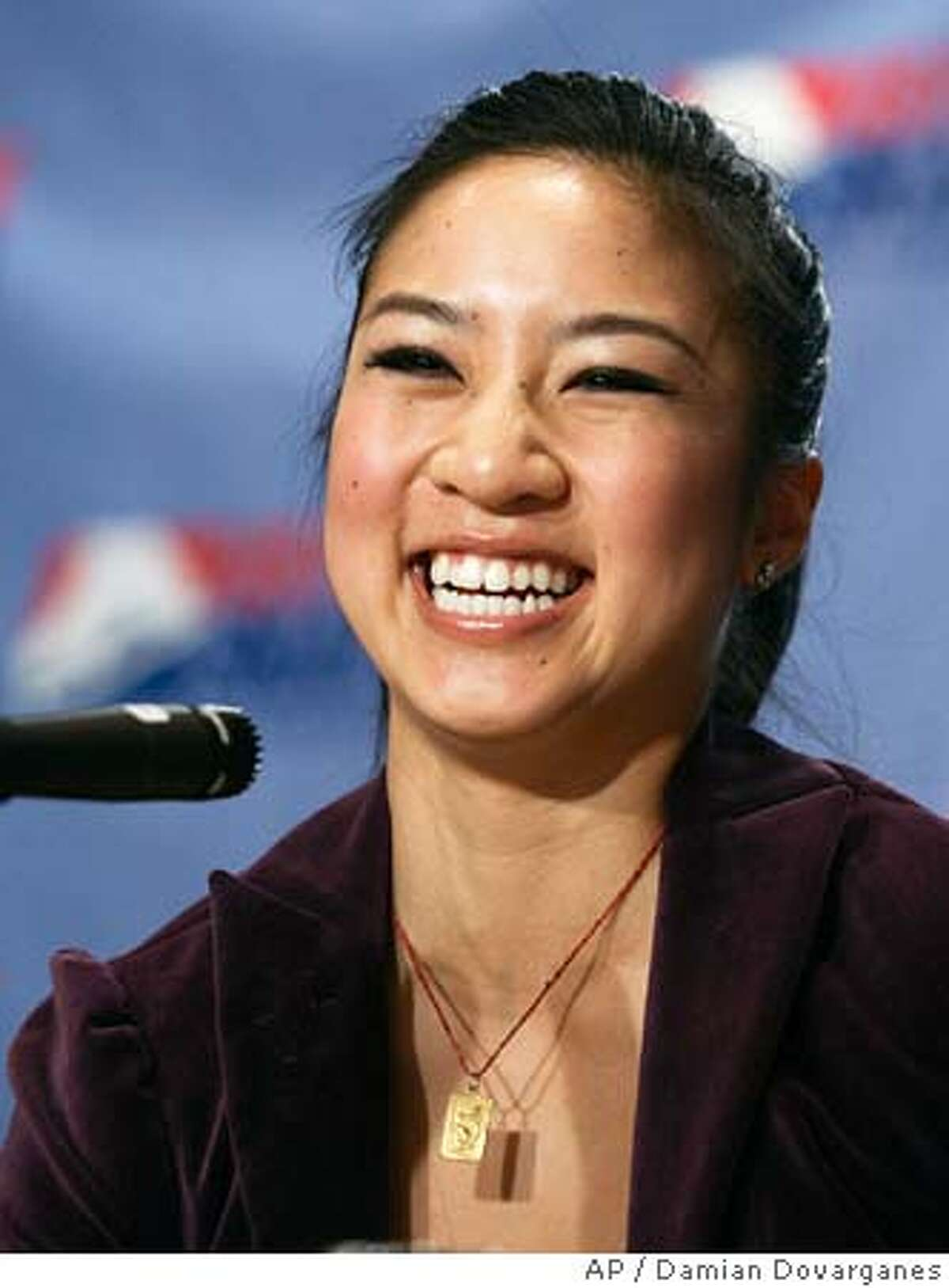 United States Olympic figure skater Michelle Kwan smiles Friday, Jan. 27, 2006, after being confirmed to compete with the 2006 U.S. Figure Skating Olympic team, during a news conference in Los Angeles. A five-person with the US Figure Skating monitoring committee watched earlier Friday morning as Kwan did her short and long programs on her home ice in Artesia, Calif. (AP Photo/Damian Dovarganes)