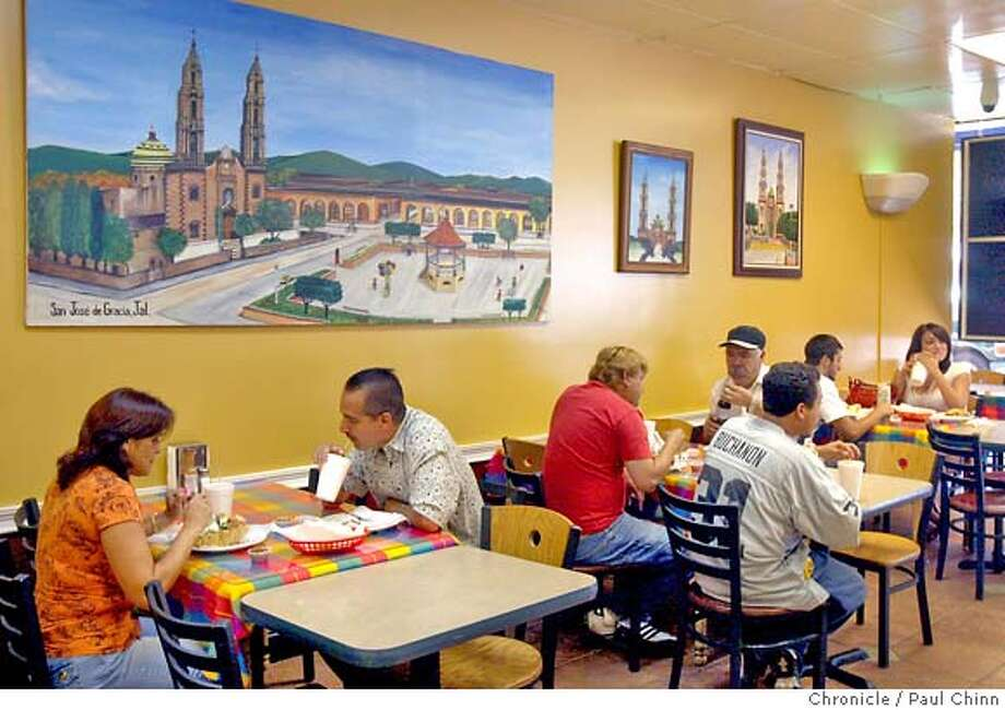 Lunch-time diners enjoy their meals at Taqueria Los Gallos in Concord, Calif. on Tuesday, August 28, 2007.  PAUL CHINN/The Chronicle MANDATORY CREDIT FOR PHOTOGRAPHER AND S.F. CHRONICLE/NO SALES - MAGS OUT Photo: PAUL CHINN