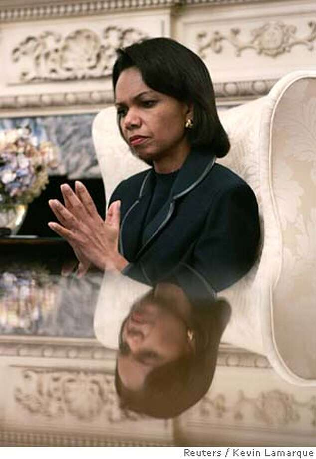 U.S. Secretary of State Condoleezza Rice puts her hands together as she talks with reporters from Reuters during an interview at the State Department in Washington January 26, 2006. Earlier in the day, Rice called Palestinian President Mahmoud Abbas and voiced continued support for him after his Fatah party lost to Hamas in an election, a presidential aide said. REUTERS/Kevin Lamarque 0 Photo: KEVIN LAMARQUE