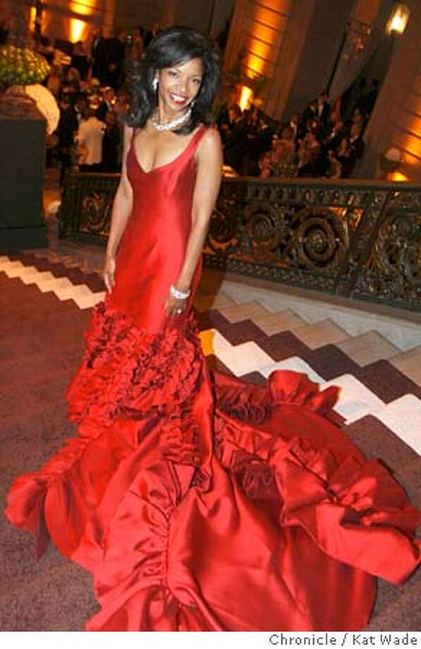 SFBALLETFASH27_0068_KW_.jpg On 1/26/06 in San Francisco Pamela Joyner, wearing a B. Michael Couture dress containing 40 yards of material poses during the opening night gala cocktail party on the staircase of City Hall before the performance of Reflections by the San Francisco Ballet.  Kat Wade/The Chronicle Mandatory Credit for San Francisco Chronicle and photographer, Kat Wade, Mags out Photo: Kat Wade