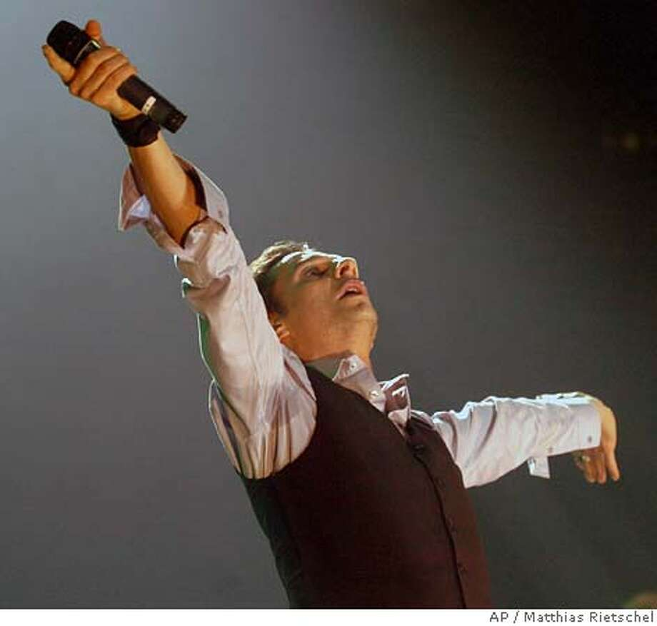 Dave Gahan of British pop group Depeche Mode performs during the first concert of their Europe Tour in Dresden, Germany, Friday, Jan. 13, 2006. (AP Photo/Matthias Rietschel) Photo: MATTHIAS RIETSCHEL