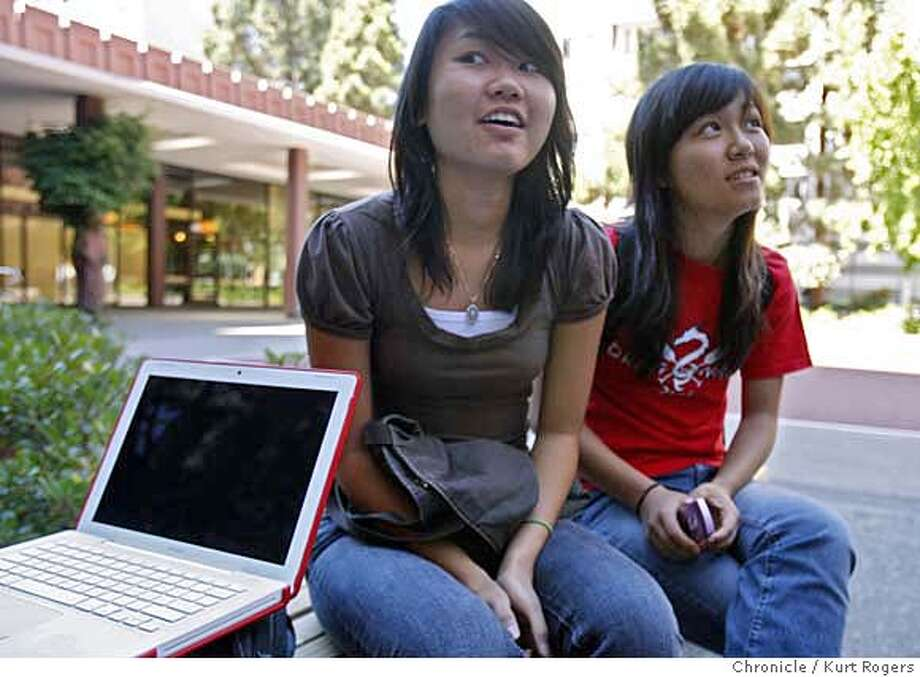 Carol Man and Ellen Chiu .  Freshman at U.C.Berkeley talk about downloading music.Universities are upping the the punishment for students who illegally download from their dorm rooms this year.  TUESDAY, SEPT 4, 2007 KURT ROGERS BERKELEY SFC  THE CHRONICLE MUSIC05_006_kr.jpg MANDATORY CREDIT FOR PHOTOG AND SF CHRONICLE / NO SALES-MAGS OUT Photo: KURT ROGERS