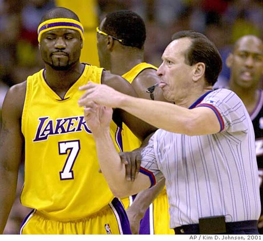 Los Angeles Laker guard Isaiah Rider (7) looks away from official Ron Olesiak as Olesiak calls a technical foul on Shaquille O'Neal, making it his sixth foul of the game and fouling out during the fourth quarter against the Utah Jazz, Wednesday, Jan. 3, 2001, in Los Angeles. The Lakers won 82-71. (AP Photo/Kim D. Johnson) DIGITAL IMAGE Photo: KIM D. JOHNSON
