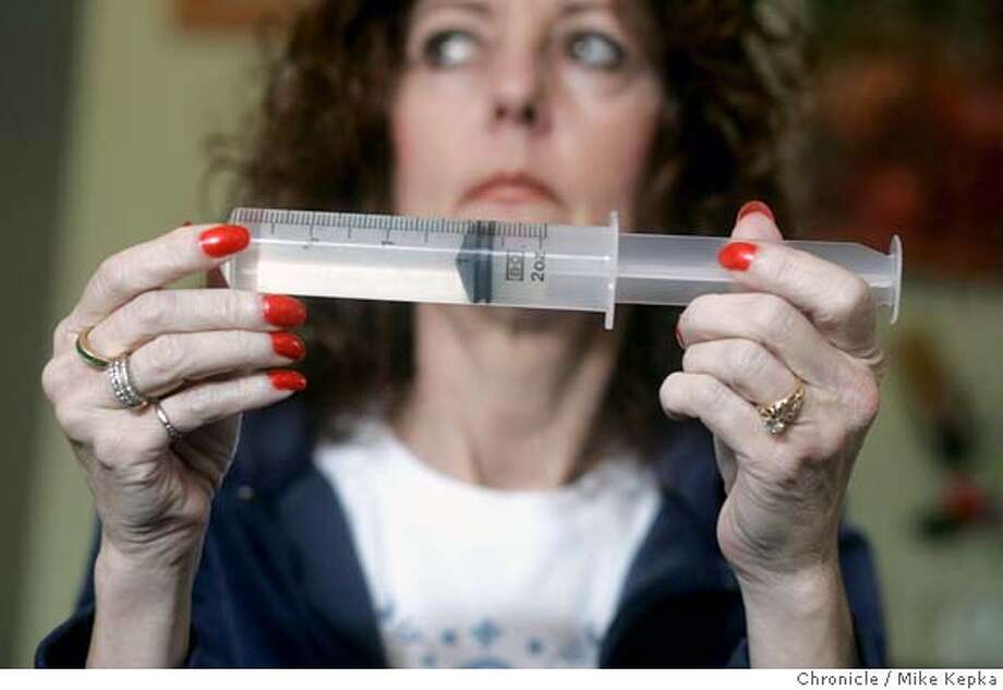 Randi Sanford, 50, has been living with cystic fibrosis for her entire life and now needs to do 4 course of antibiotics a day to keep infections from attacking her body. insurance does not want to pay for the pre-mixed tubes of medications. They pay for most things just not the pre-mixed medication like the tube she is holding here. sacramento on 1/25/06. Mike Kepka / The Chronicle 8 Photo: Mike Kepka