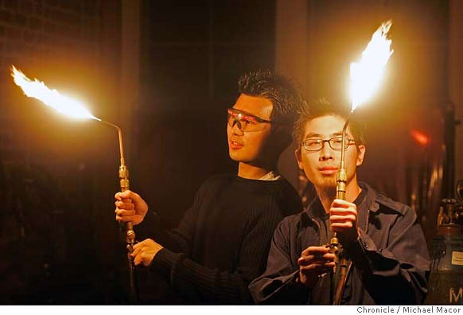 stanfordengineering_042_mac.jpg Sun Kim, left was given the task of imitated the sonar of a bat while Mike Lin, right, had to design a working scorpion tail. For Kim, who grew up in rural South Korea observing animals, it was an opportunity to put into practice something he is always been interested in. Sun Koo Kim never thought enrolling at Stanford University as a mechanical engineering student would land him on television, much less send him flying through the air suspended by cables wearing an invention designed to replicate the sonar hunting capabilities of bats. But when Chasing Nature, an Animal Planet show on the Discovery Channel, showed up on Stanford�s campus to ask the nation�s brightest, most creative engineering minds to design devices that imitate the capabilities of animals, Kim was intrigued by the challenge. So were nine other classmates, all of whom who are appearing on episodes of Chasing Nature, which began airing in December and will continue throughout the spring.For Kim, who grew up in rural South Korea observing animals, it was an opportunity to put into practice something he is always thinking about: using the beauty and elegance found in nature for inspiration in his designs. Event in Palo Alto, Ca on 1/10/06. Photo by: Michael Macor / San Francisco Chronicle Mandatory Credit for Photographer and San Francisco Chronicle/ - Magazine Out Photo: Michael Macor