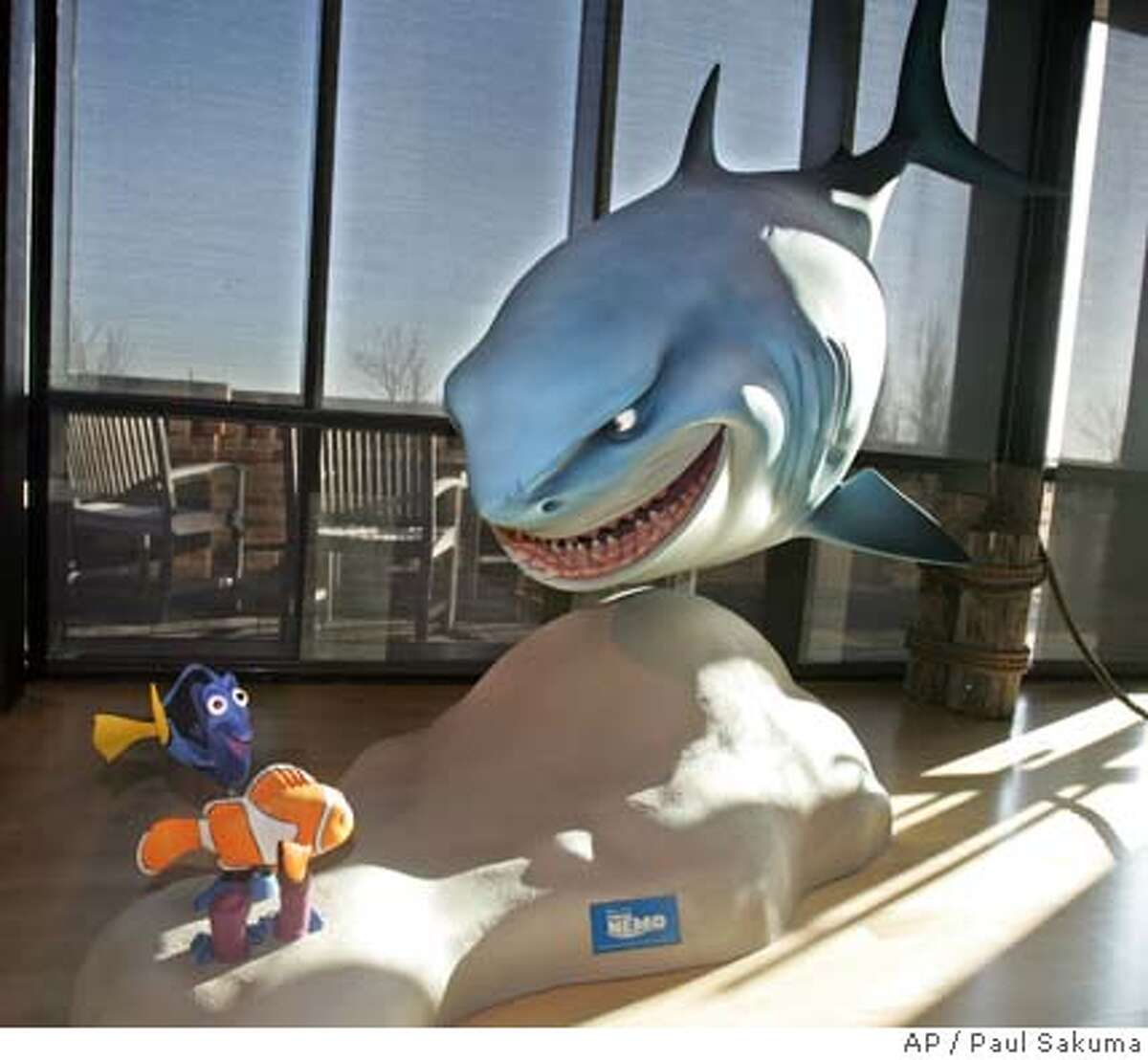 """Characters from the Pixar Animation Studios Inc. movie """"Finding Nemo"""" are shown in the lobby of Pixar headquarters in Emeryville, Calif., Tuesday, Jan. 24, 2006 after Walt Disney Co. announced it is buying longtime partner Pixar. (AP Photo/Paul Sakuma) Ran on: 01-26-2006 Finding Nemo characters from the Pixar Animation Studios movie decorate the lobby of Pixar headquarters in Emeryville."""