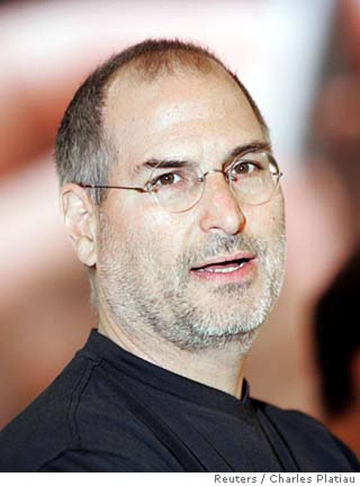 Apple Computer Inc. Chief Executive Steve Jobs poses on opening day of Paris Apple Expo 2005