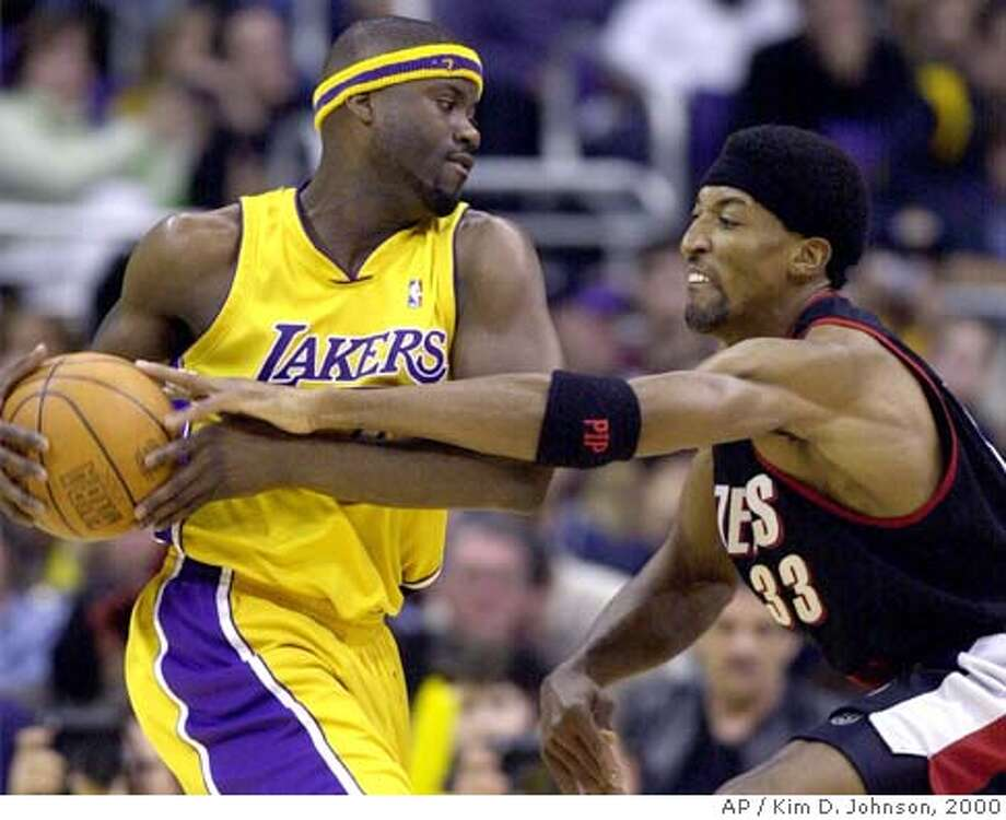 Portland Trail Blazers forward Scottie Pippen, right, tries to tip the ball away from Los Angeles Lakers guard Isaiah Rider in the second half in Los Angeles, Monday, Dec. 25, 2000. Portland won 109-104. (AP Photo/Kim D. Johnson) Photo: KIM D. JOHNSON