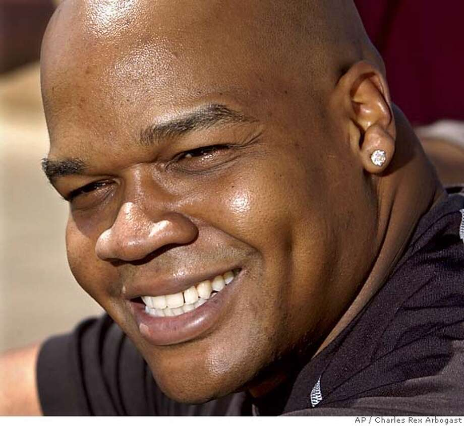 ** FILE ** Chicago White Sox slugger Frank Thomas smiles as he talks with reporters in this file photo from spring training in Tucson, Ariz., March 7, 2005. Thomas agreed to a $500,000, one-year contract with the Oakland Athletics on Wednesday, Jan. 25, 2006, giving the A's the big bat they've been searching for in the middle of their lineup. Thomas, a two-time American League MVP who has been slowed by injuries in recent years, can make an additional $2.6 million in bonuses based on plate appearances and not hurting his left foot. (AP Photo/Charles Rex Arbogast) MARCH 7, 2005, PHOTO EFE OUT Photo: CHARLES REX ARBOGAST