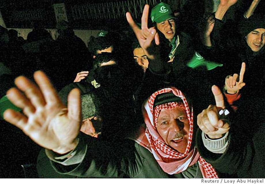 Supporters of Hamas gesture after polls closed in a Palestinian election in the West Bank city of Hebron January 25, 2006. Islamic militant group Hamas made a strong showing in the Palestinian parliamentary election on Wednesday, just a few percentage points behind the ruling Fatah movement, first projections showed. REUTERS/Loay Abu Haykel Ran on: 01-26-2006  Supporters of Hamas gesture after polls closed in the West Bank city of Hebron. This was the militant group's first campaign in a national election. Photo: LOAY ABU HAYKEL