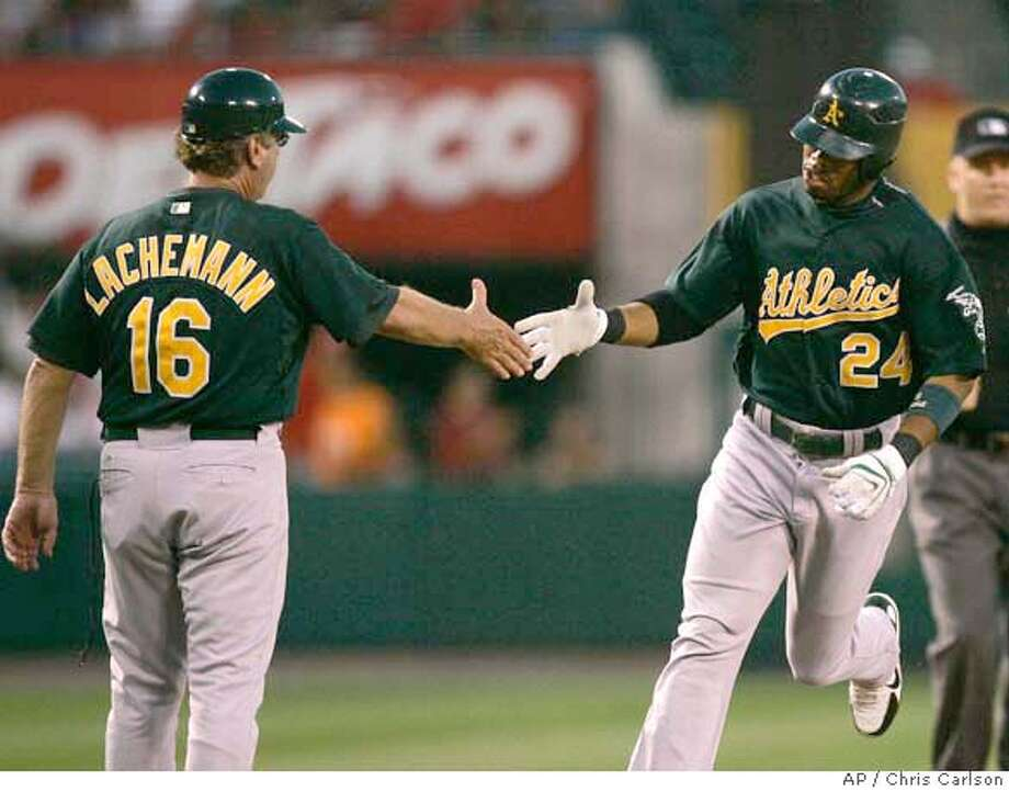 Oakland Athletics' Shannon Stewart (24) is greeted by third base coach Rene Lachemann after hitting a solo home run against the Los Angeles Angels during the first inning of a baseball game in Anaheim, Calif., Tuesday, Sept. 4, 2007. (AP Photo/Chris Carlson) Photo: Chris Carlson