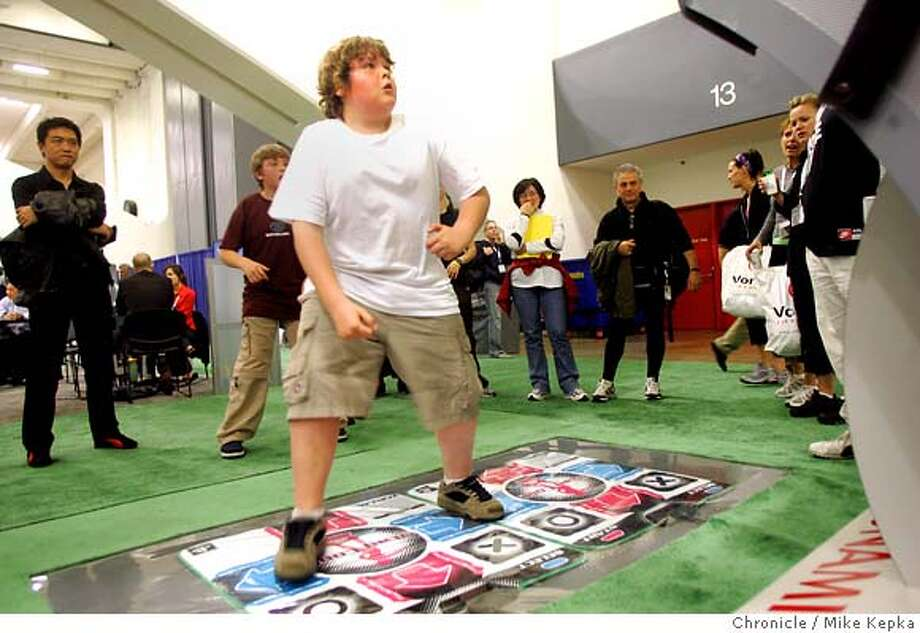 treadmill055_mk.jpg  Steven Trothen , 11, of London Onterio, Canada, works out on the dance floor of the fitness game Dance Dance Revolution Extreme which is made by Konami.  Fitness fanatics from around the world come to Moscone Center for the International Health and Racquet Sportsclub Association.  Mike Kepka / The Chronicle MANDATORY CREDIT FOR PHOTOG AND SF CHRONICLE/ -MAGS OUT Photo: Mike Kepka