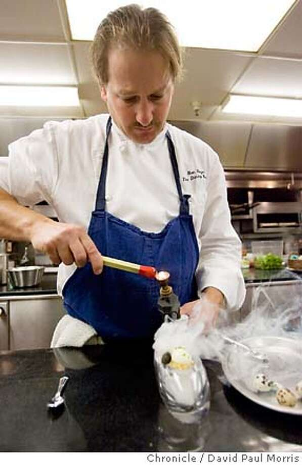 SAN FRANCISCO, CA - AUGUST 24: A 64 C degree Quail Egg with golden Osetra Caviar, crouton smoked with cedar smoke made by Executive Chef Ron Siegel is seen at the Ritz Carlton on August 24, 2007 in San Francisco, California. (Photo by David Paul Morris/The Chronicle) Photo: David Paul Morris
