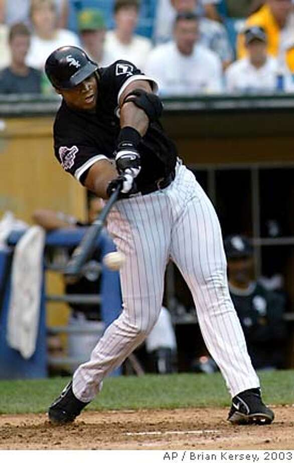 Chicago White Sox's Frank Thomas connects on an RBI single scoring Tony Graffanino during the sixth inning against the Tampa Bay Devil Rays on Sunday, July 27, 2003, in Chicago. Thomas went 2-5 with a homer and three RBIs in the White Sox 9-1 win. (AP Photo/Brian Kersey) Photo: BRIAN KERSEY