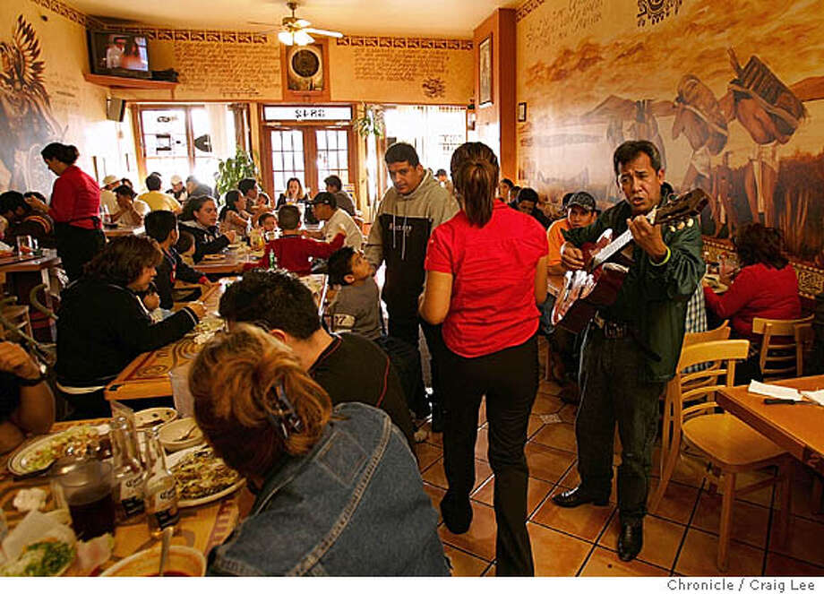 INTLBLVD25_1193_cl.JPG  Story about the Latino feel and flavor of International Boulevard in Oakland, formerly East 14th Street. This photo is from El Huarache de Azteca restaurant at International Blvd. between 38th and 39th street. Photo of Rafael Matthew delighted the crowd with his Mexican songs on his guitar. The crowd seemed very pleased and happily applauded after each song he did.  Event on 1/8/06 in Oakland. Craig Lee / The Chronicle MANDATORY CREDIT FOR PHOTOG AND SF CHRONICLE/ -MAGS OUT Photo: Craig Lee