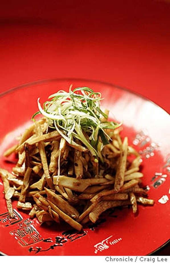 SEASONAL25_045_cl.JPG  Chef Alexander Ong of Betelnut restaurant in San Francisco talks about the seasonal vegetables that go into a Chinese New Year's dinner. The main emphasis will be on fresh bamboo shoots. Photo of a plate of bamboo salad by Alexander Ong.  Event on 1/10/06 in San Francisco. Craig Lee / The Chronicle MANDATORY CREDIT FOR PHOTOG AND SF CHRONICLE/ -MAGS OUT Photo: Craig Lee