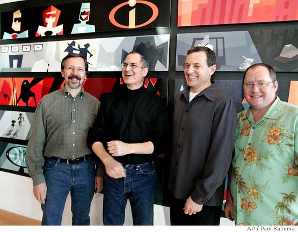Walt Disney Co. CEO Robert Iger, center right, smiles with Pixar Animation Studios Inc. CEO Steve Jobs, center left, at Pixar headquarters in Emeryville, Calif., Tuesday, Jan. 24, 2006 after Disney announced it is buying longtime partner Pixar. Also smiling is Pixar Executive Vice President of Creative, John Lasseter, right, and Ed Catmull, President of Pixar, left. (AP Photo/Paul Sakuma) Ran on: 01-25-2006 Pixar CEO Steve Jobs (center left) and Disney CEO Robert Iger (center right), with Pixars Ed Catmull (left) and John Lasseter. Ran on: 01-25-2006 Pixar CEO Steve Jobs (center left) and Disney CEO Robert Iger (center right), with Pixars Ed Catmull (left) and John Lasseter.