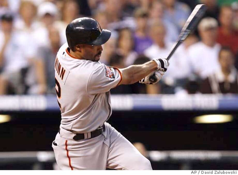 San Francisco Giants' Randy Winn follows through with his swing after connecting for a three-run home run off Colorado Rockies starting pitcher Franklin Morales in the third inning of a Major League Baseball game in Denver, Tuesday, Sept. 4, 2007. (AP Photo/David Zalubowski) Photo: David Zalubowski